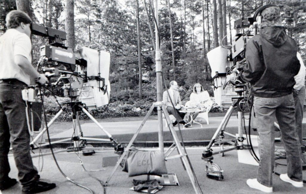 """""""CBS This Morning"""" signed on from the WRAL Azalea Gardens on April 25, 1988, with anchors Harry Smith and Kathleen Sullivan. The show didn't normally leave its NY studios for remote origins. Another unique feature: the entire content of the program that day dealt exclusively with the state of North Carolina."""